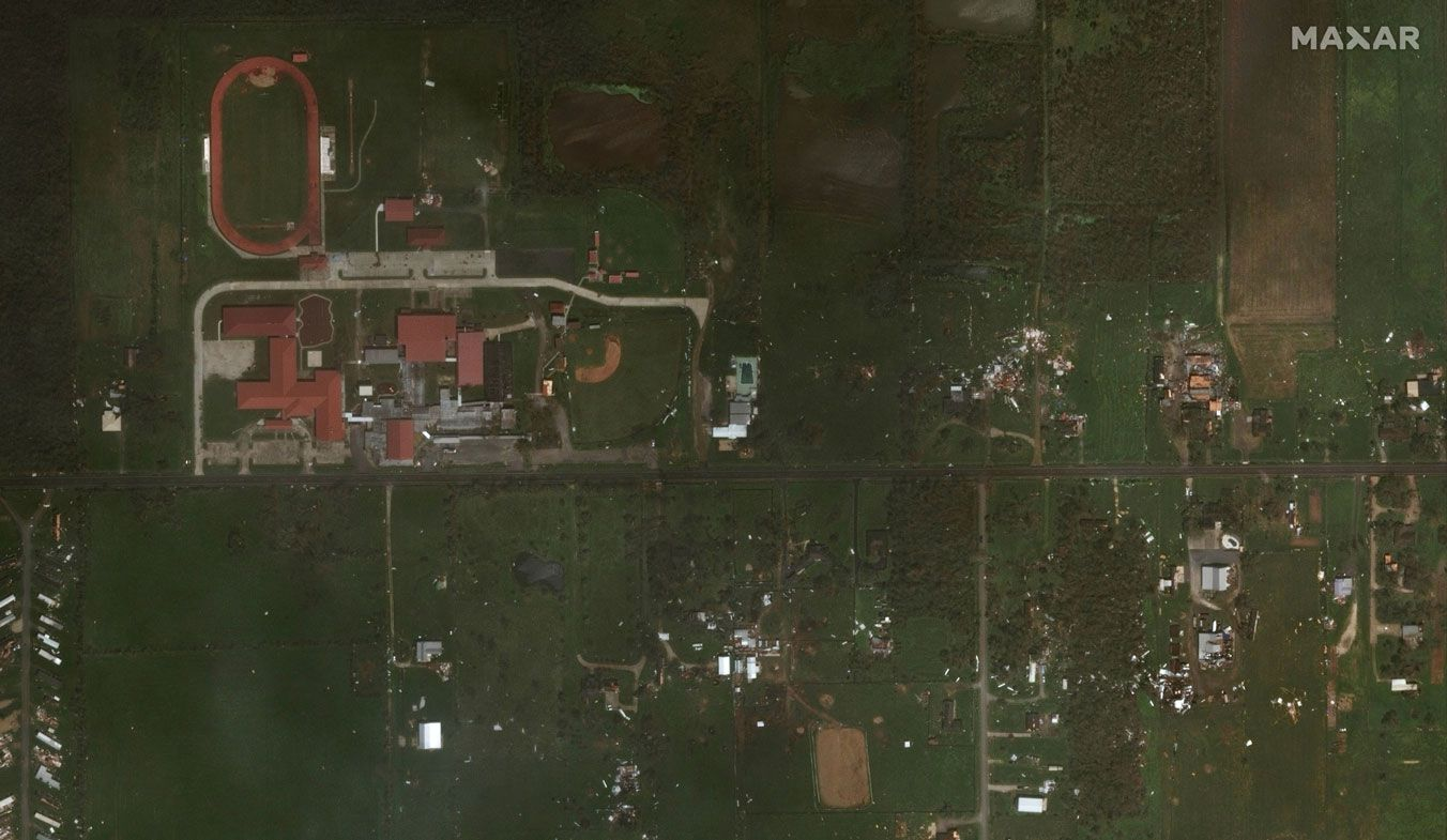 This Aug. 27, 2020, satellite photo provided by Maxar Technologies shows Grand Lake High School and nearby homes south of Lake Charles, La., after Hurricane Laura.