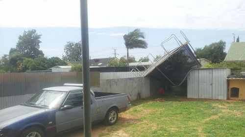 Adelaide resident Jimmy Charles discovered a trampoline had been flung into his yard. (Supplied, Jimmy Charles)