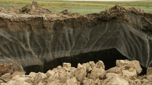 The rim of a recently discovered crater in the Yamal Peninsula, in Yamalo-Nenets Autonomous Okrug, Russia. (AAP)