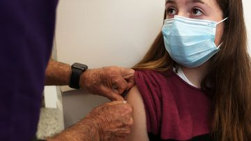 Ivy Goodall, receives a COVID-19 vaccination.