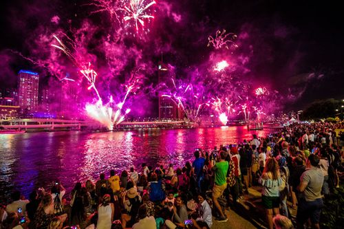 Revellers watch fireworks above Brisbane.
