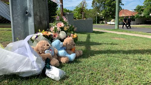 Flowers and tributes for the family left at the scene.