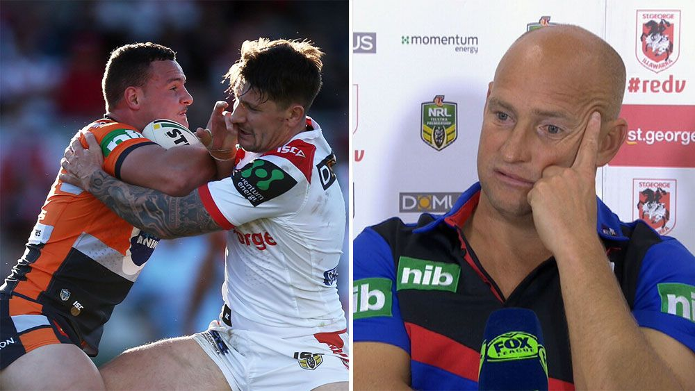 Newcastle coach Nathan Brown sprays young Knights halves following loss to St George Illawarra