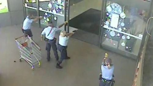 Police surrounded the entrance to the shopping centre with their tasers drawn after the man attempted to escape (9NEWS)