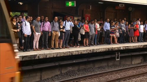 Commuters were late for work as 1300 services have been cut. (9NEWS)