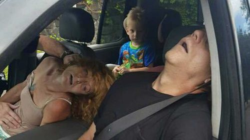 The East Liverpool Police Department in Ohio released this confronting image of a grandmother and her friend passed out in their car with a child in the back seat, in order to draw attention to the scourge of heroin in that rural town.