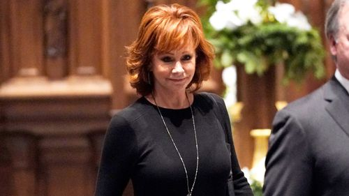 Country music star Reba McEntire was due to be among the musical performers at today's service.