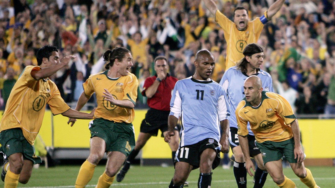 Australian players Tim Cahill, Harry Kewell, Mark Viduka (back right) celebrate after teammate Marco Bresciano scored against Uruguay in their World Cup qualifier in Sydney, 2005.