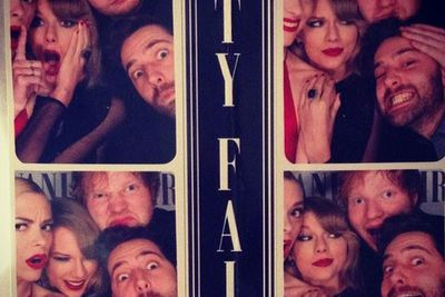 Photo booth fun at the Vanity Fair after-party! We see that side-eye Taylor...