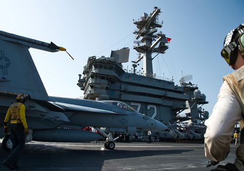 An F/A-18 fighter jet taxis on the deck of the USS Abraham Lincoln aircraft carrier in the Arabian Sea. US President Donald Trump last week called off air strikes on Iran, deciding instead to launch cyber attacks on Iranian targets.