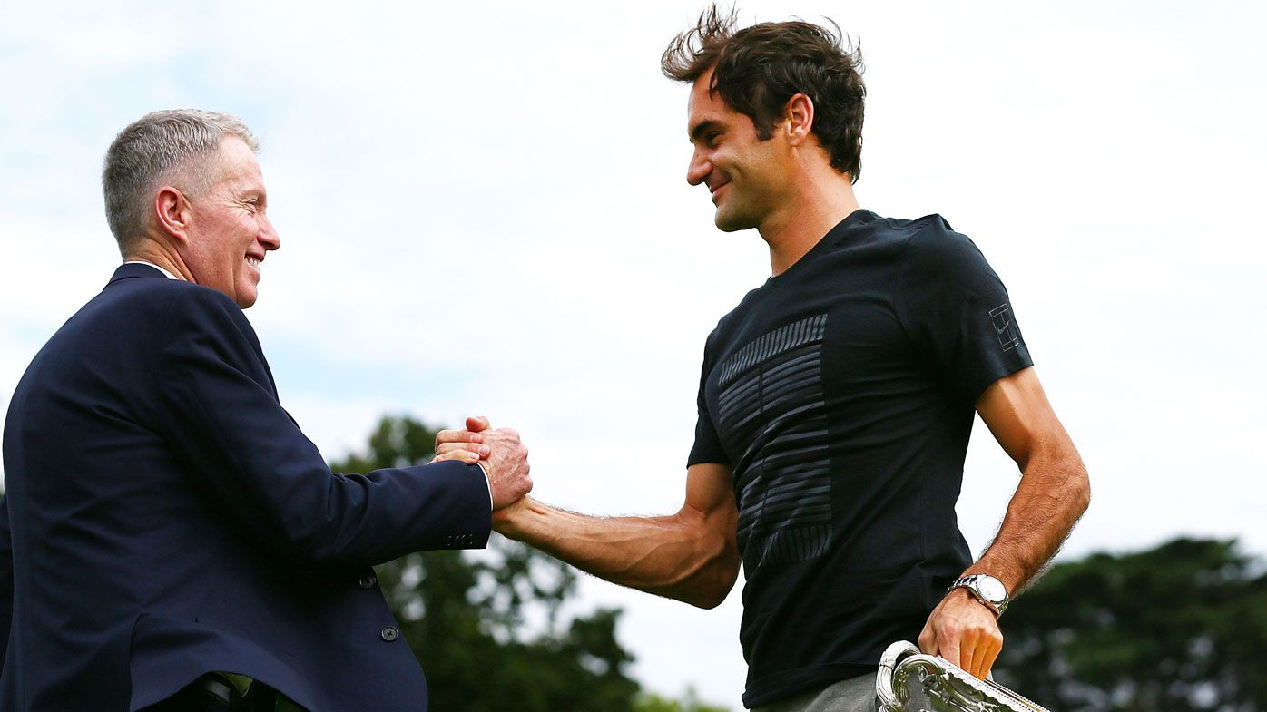 Roger Federer and Craig Tiley