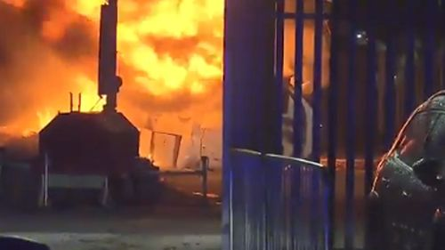 The helicopter burst into flames after crashing into a car park.