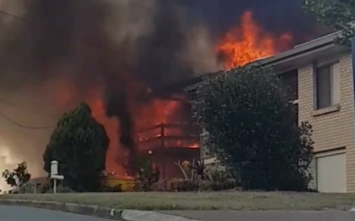 A woman suffered burns to her arm in the Arana Hills house fire.