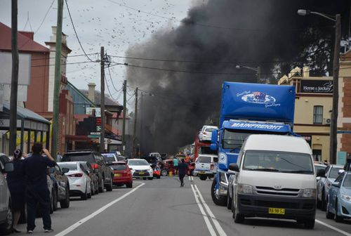 The crash has caused smoke to billow across the town.