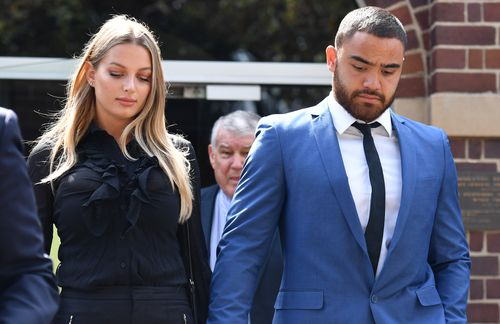 Manly Sea Eagles player Dylan Walker leaves court with his partner Alexandra Ivkovic after being charged with assault on December 11.