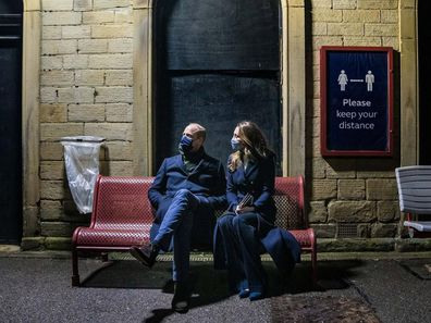 Prince William and Kate Middleton wait at train station during Royal Train tour.