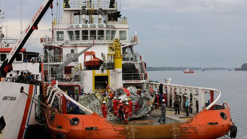 Parts of AirAsia Flight 8501 is seen on the deck of rescue ship Crest Onyx. (AAP)