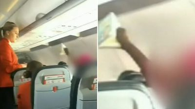 'Aggressive' woman hauled off Jetstar flight after hurling abuse at crew