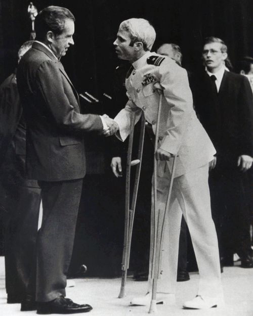 John McCain is greeted by President Richard Nixon in Washington during the spring of 1973 after spending more than five years in a Vietnamese prisoner of war camp. Solitary confinement was McCain's fiercest enemy during his more than five years as a prisoner of war in Vietnam, an experience he says taught him confidence, humility and the ambition to pursue larger dreams after he was released. (AAP)