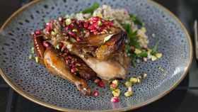 Pomegranate glazed BBQ spatchcock, with mint, pistachio and bulgur salad