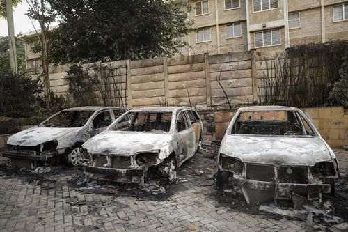 Cars were blown up outside the luxury complex.