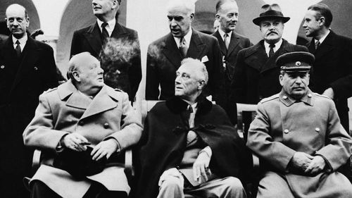 Vyacheslav Nikonov's grandfather (back row, second from right) Vyacheslav Molotov, at the Yalta Conference with Winston Churchill, Franklin Roosevelt and Josef Stalin. (AAP)