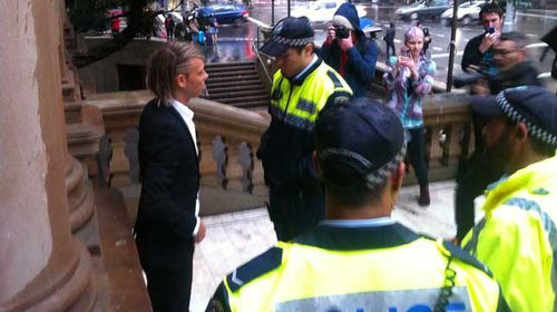 Jesse Willesee was arrested at 4.21pm, just one minute after he dared to light a joint on the steps of Sydney Town Hall. (Supplied)