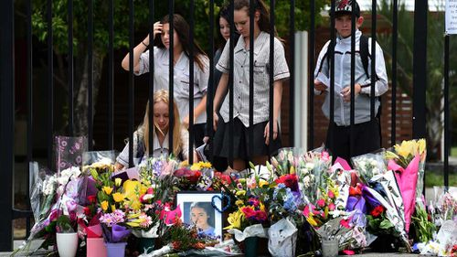 Fellow students place floral tributes for Tiahleigh. (AAP)