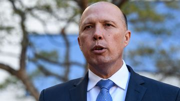 A Federal Government Bill released by Peter Dutton's office is proposing a facial identity matching service. (AAP)