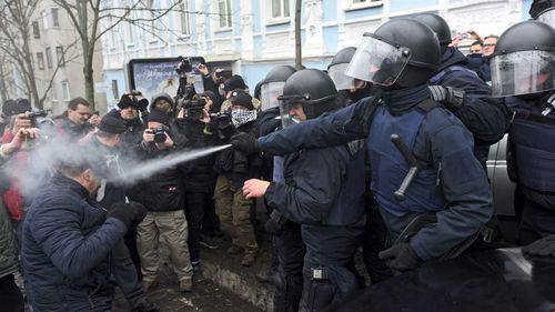 Ukrainian police use tear gas on supporters of Mikheil Saakashvili in Kiev. (AAP)