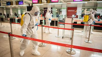 Barcelona Airport in Spain is cleaned by staff.