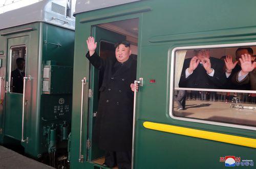 The North Korean leader waving as he boards a train in Pyongyang, North Korea.