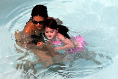 Suri learnt to swim this summer in Miami