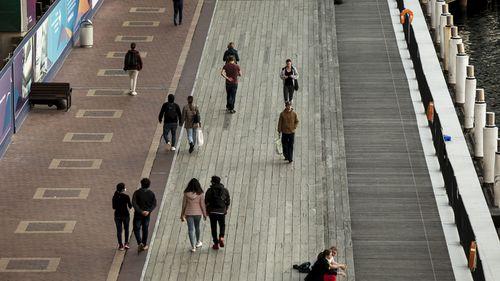 Generic. Commuters, pedestrians, in Darling Harbour, Sydney on August 4, 2020. coronavirus.