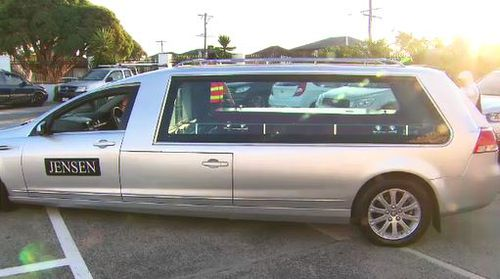 Aya's body arriving in a hearse before a memorial ceremony at a Dandenong Mosque.