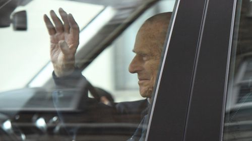 Prince Philip waves as he leaves hospital. (AP/AAP)