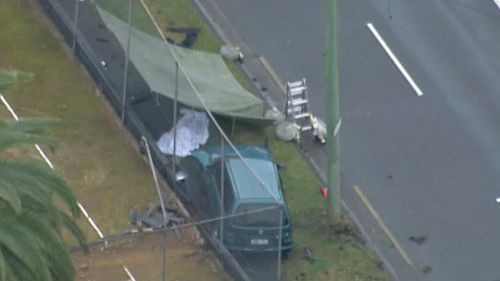 A woman has died after being hit by a car while walking on a footpath at Chatswood. (9 News)