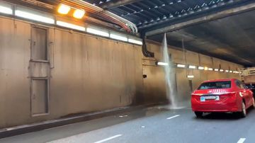 A water pipe, believed to be part of the tunnel's sprinkler system, was struck by the truck.