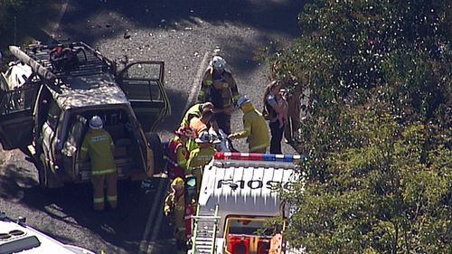 Police are investigating the crash between the four-wheel-drive and station wagon. (9NEWS)
