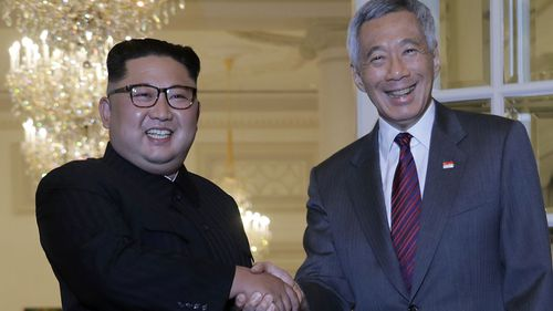 North Korean leader Kim Jong Un meets with Singapore's Prime Minister Lee Hsien Loong at the Istana or presidential palace.