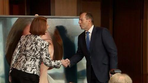 Ms Gillard and Mr Abbott shake hands - finally.