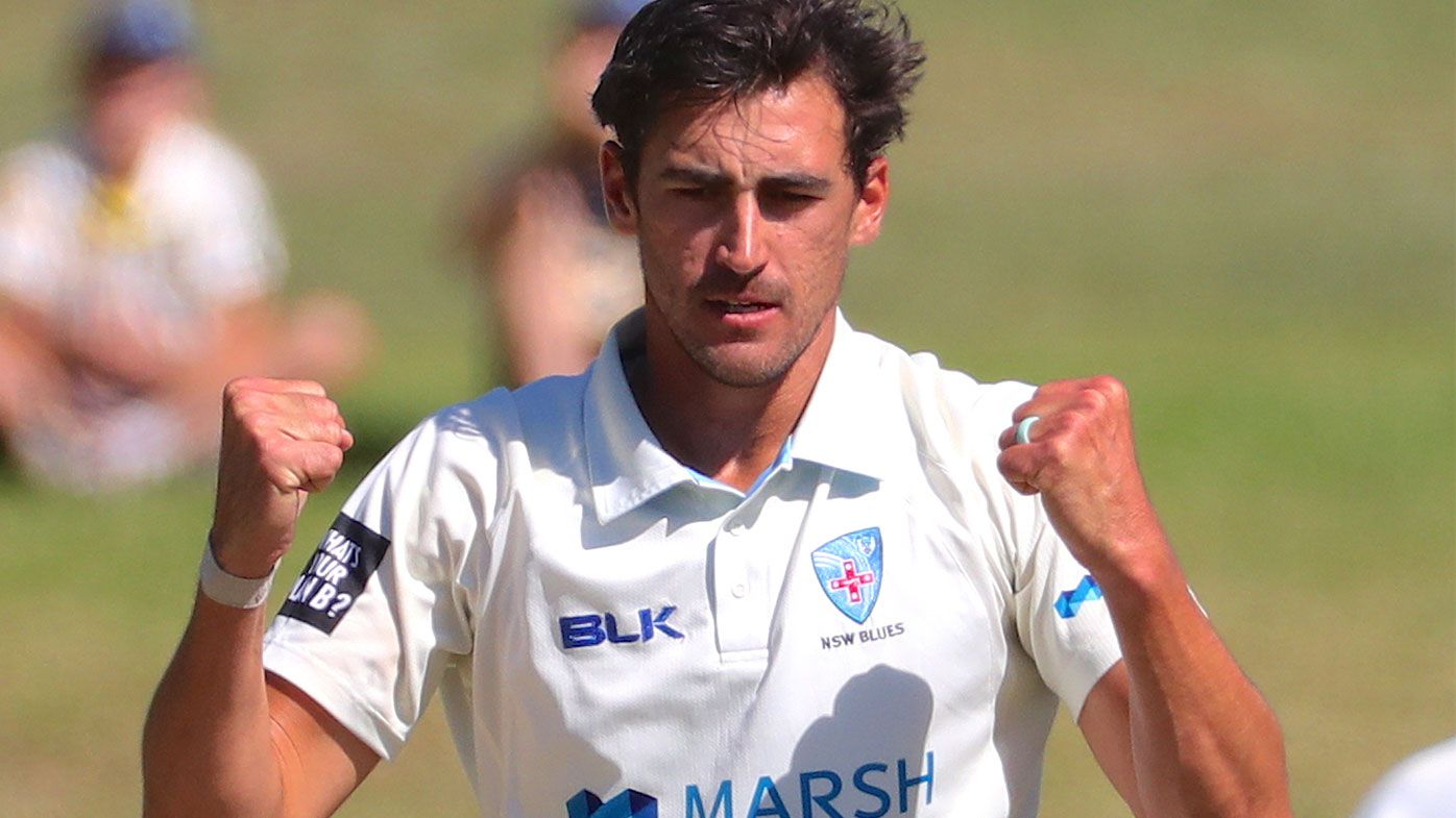 NSW bowler Mitchell Starc celebrates dismissing Tasmania's Jordan Silk LBW