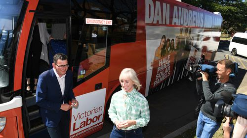 Daniel Andrews and wife Catherine hop off the Labor campaign bus.