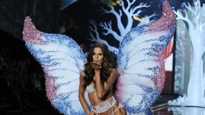 Brazilian beauty Izabel Goulart blows a kiss into the crowd at the Victoria's Secret Fashion Show in London. (AAP)