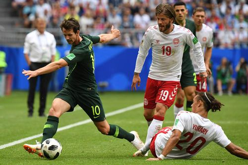 Australia's Mathew Leckie comes under pressure from Denmark during their FIFA World Cup match. Picture: AAP