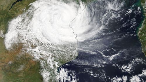 A handout photo made available by the NASA shows a Terra/MODIS satellite image of cyclone Idai as it hits Mozambique.