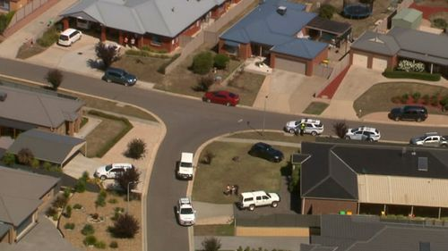 Police have established a crime scene outside a day care centre after a toddler died. (9NEWS)
