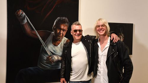 Artist Jamie Preisz and entertainer Jimmy Barnes pose with the Packing Room Prize winning portrait at the Art Gallery of New South Wales in Sydney, Thursday, May 3, 2018. (AAP Image/Mick Tsikas)