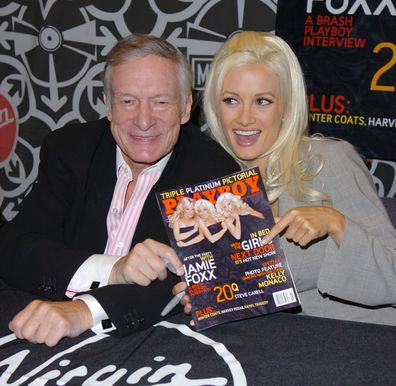 Hugh Hefner and Holly Madison  sign the November 2005 Issue of Playboy in New York in 2005.