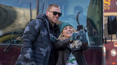 Philadelphia Eagles NFL football player Zach Ertz, left, stops to take a photo with his wife, Julie Ertz. (AAP)